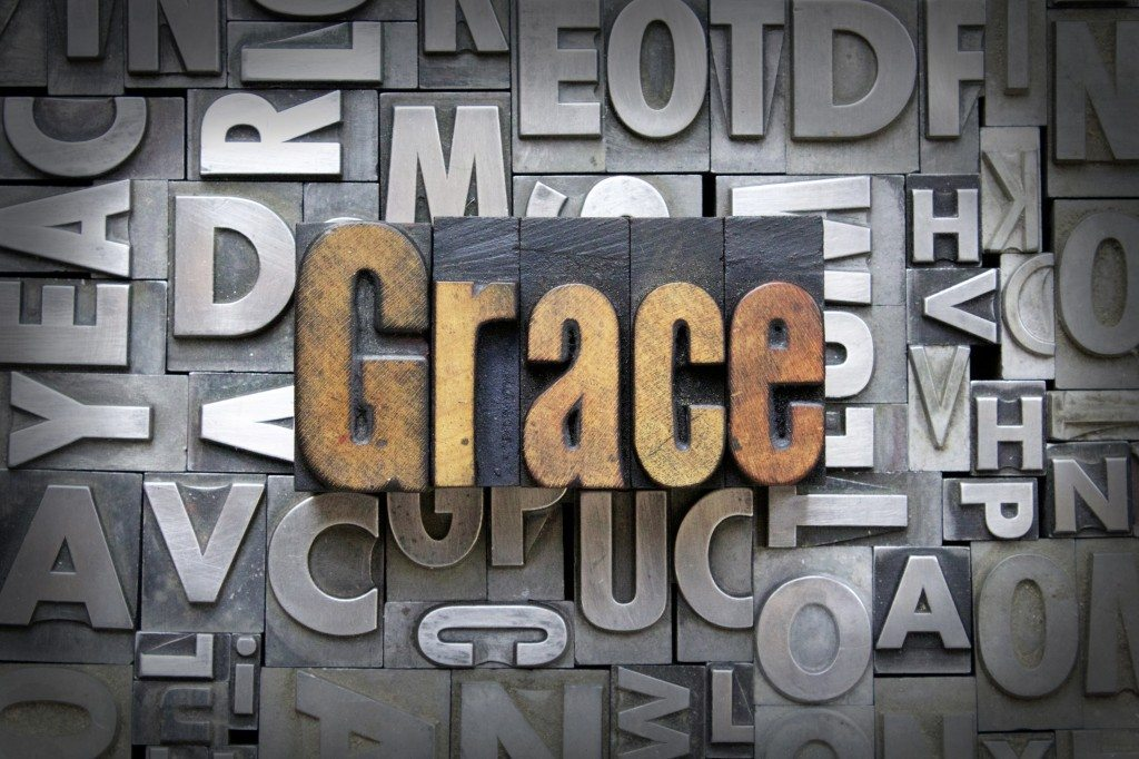 grace graphic placed over metal letters