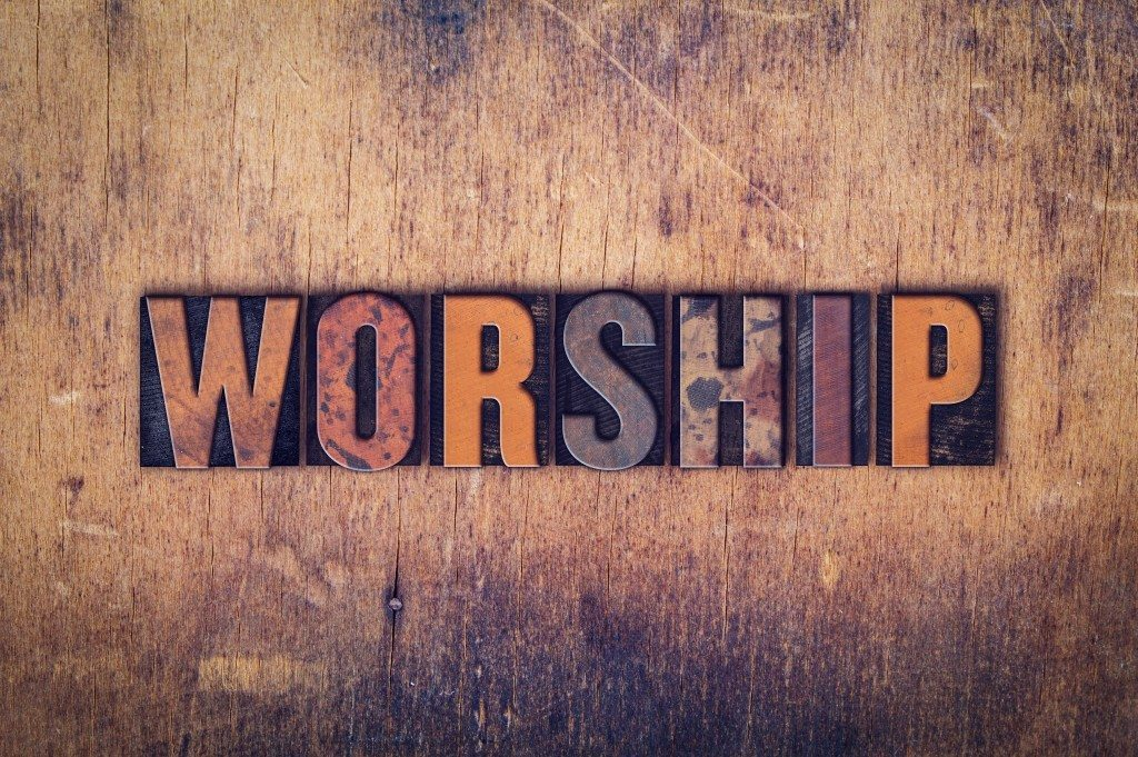 worship graphic spelled out on wood with multi-colored letters